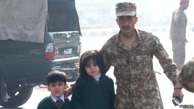 Soldiers help evacuate children