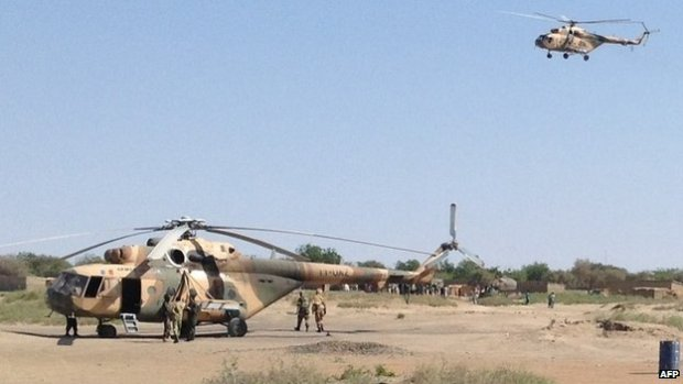Mi-24 attack helicopters are seen in Fotokol, Cameroon, on 1 February 2015 after an operation in nearby Gamboru, Nigeria