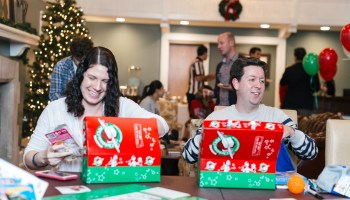 Alumni pack Operation Christmas Child boxes in the Foutch Alumni House.