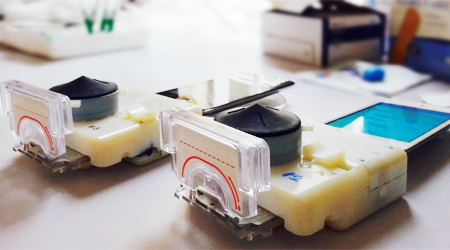 Smartphone dongles performed a point-of-care HIV and syphilis test in Rwanda from finger prick whole blood in 15 minutes, operated by health care workers trained on a software app. Image credit:  Samiksha Nayak for Columbia Engineering