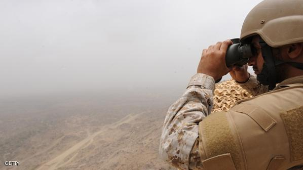 A Saudi soldier looks through binoculars from a position at al-Dokhan mountain, on the Saudi-Yemeni border, in southwestern Saudi Arabia, on April 13, 2015. Saudi Arabia is leading a coalition of several Arab countries which since March 26 has carried out air strikes against the Shiite Huthis rebels, who overran the capital Sanaa in September and have expanded to other parts of Yemen. AFP PHOTO / FAYEZ NURELDINE        (Photo credit should read FAYEZ NURELDINE/AFP/Getty Images)