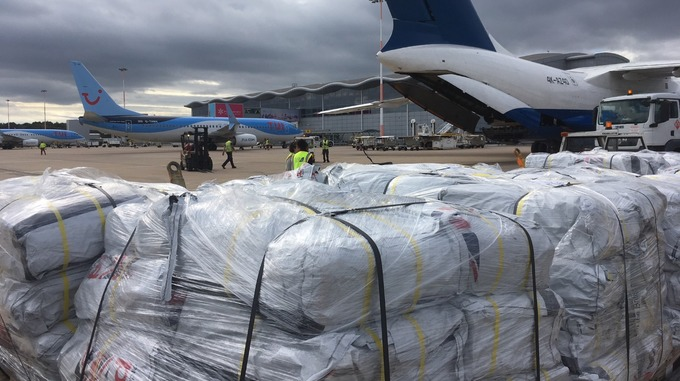 Aid destined for Indonesia disaster zone loaded onto cargo plane at