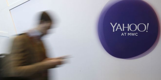 A man walks past a Yahoo logo during the Mobile World Congress in Barcelona, Spain February 24, 2016. REUTERS/Albert Gea - RTX28D2X