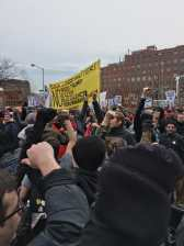DSA members raise their fists in solidarity with the Black Lives Matter movement during the inauguration protests. (Derek Robertson/MEDILL)