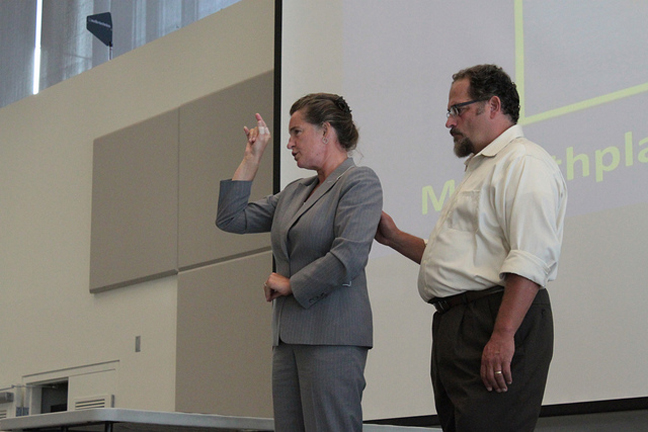 Jelica Nuccio, the first deaf-blind director of the Seattle Deaf-Blind Service Center, (right) gives the keynote address at the 2012 Barriers Summit.