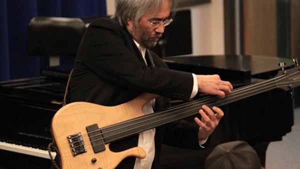 "Steve Kim plays during a faculty recital in 2012. Kim plays upright bass on Soundgarden-member Ben Shepherd's new album, ""In Deep Owl."""