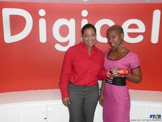 Shamanda Dider happily collected her new camcorder from Digicel's Sergin Joseph.