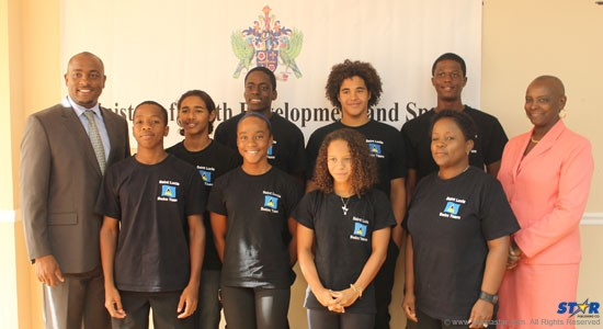Minister of Youth Development and Sports, Shawn Edward (extreme left) and Acting Permanent Secretary, Fortuna Belrose (extreme right) with members of the National Swim Team competing at CARIFTA.