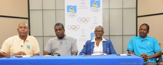 "From left to right executive members of the St Lucia Olympic Committee (SLOC): David ""Shakes"" Christopher; SLOC Second Vice President, Ricardo Bowe; SLOC President Fortuna Belrose and Jerome Girard."