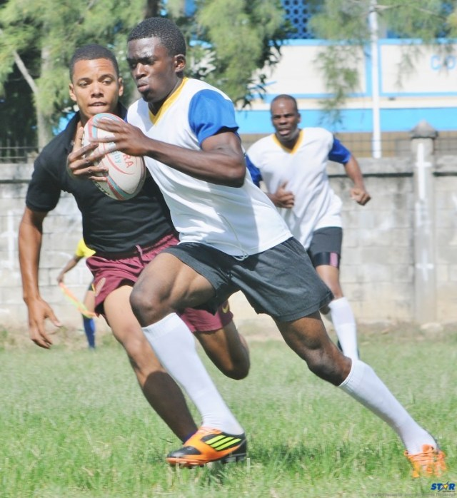 A St Lucia player breaks away and heads for the open field.