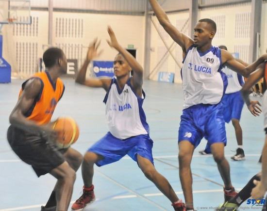 The school basketball team (white jerseys) representing St Lucia at the Windward Islands School Games played in this year's National Basketball Tournament.