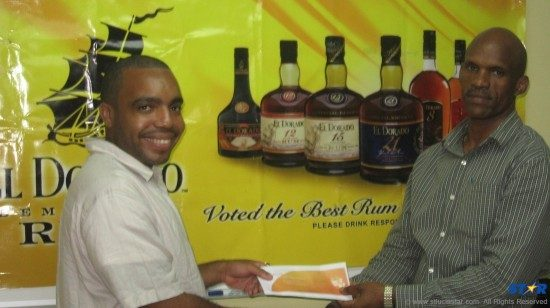 Damian Francois of Peter & Company presents Mr Jean with his tickets.