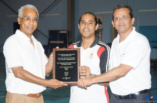 President of the St Lucia National Table Tennis Association, Teddy Matthews (l) received this plaque from Trinidad and Tobago Coach, Reeza Burke (center); and President of the Caribbean Region Table Tennis Federation, Juan Villa; for St Lucia's successful hosting of the Caribbean Table Tennis Championships.