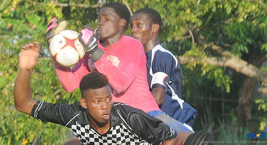While sandwiched between an Aux Lyons United player (checkered jersey) and a defender the RYO goalkeeper came up with this big save following a corner kick.