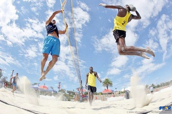 Joseph Clercent (r) and Julian Bissette (background) will compete for St Lucia at the NORCECA Beach Tour which got underway today at Pigeon Island Landmark.