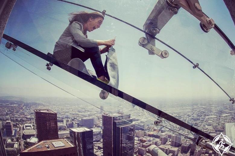 صور: زلاقة شفافة على ارتفاع 305 متر بين ناطحات السحاب