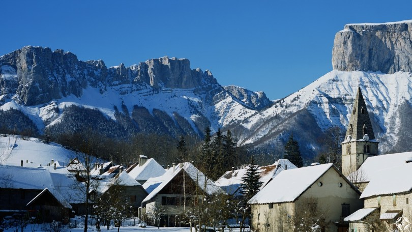 France, Chichilianne, snow covered village in mountainous landscape