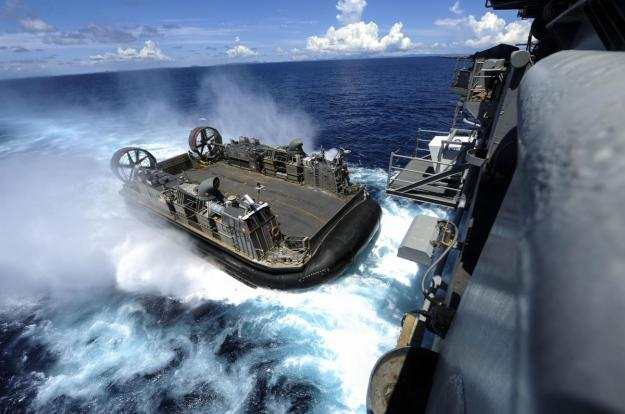 A landing craft air cushion enters the welldeck of the amphibious assault ship USS Bonhomme Richard (LHD 6) to reload Marines and equipment for a certification exercise. Sept. 2, 2012U.S. Navy Photo