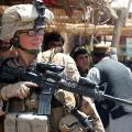 Lance Cpl. Stephanie Robertson, a member of the female engagement team (FET) assigned to 2d Battalion, 6th Marine Regiment, Regimental Combat Team 7,  in Marjah, Afghanistan, in 2010. USMC Photo