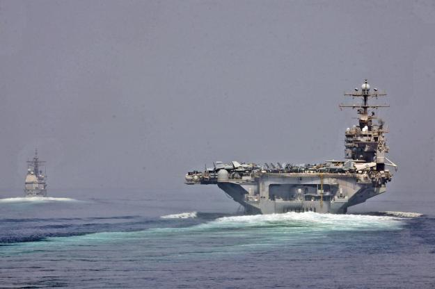 U.S. Navy photo of the USS Enterprise and USS Cape St. George transitioning through the Strait of Hormuz on May 11.