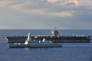 The aircraft carrier USS Enterprise (CVN 65) is underway with the Royal Navy Type 45 destroyer HMS Daring (D-32) in 2010. The US and UK are exploring integrating the Type 45 into US European ballistic missile defense programs. US Navy Photo