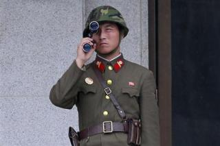 A North Korean soldier looks south through a pair of binoculars on the north side of the truce village of Panmunjom. Reuters Photo