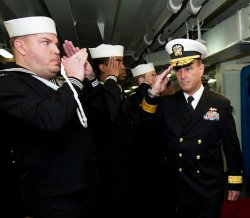 Rear Adm. Charles M. Gaouette receives honors from side boys during a change of command ceremony for Commander, Carrier Strike Group (CSG) 3 on April 5, 2012. US Navy Photo