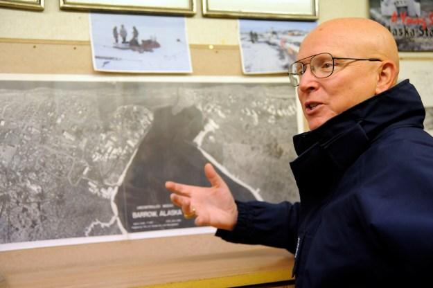 Coast Guard Commandant, Adm. Robert Papp, in front of a map of Barrow, Alaska during a recent trip. US Coast Guard Photo