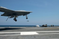 X-47B Unmanned Combat Air System (UCAS-D) demonstrator completes an arrested landing on the flight deck of the aircraft carrier USS George H.W. Bush (CVN-77). US Navy Photo
