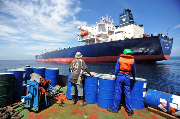 A crew member prepares to board a tanker that was hijacked by pirates in Benin on 24 July 2011. UN Photo