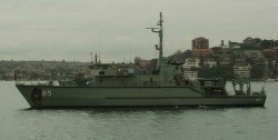 The Huon class minehunter HMAS Gascoyne, anchored in Sydney Harbour following a ceremonial fleet entry