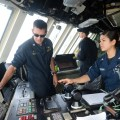 Cmdr. Pat Thien, left, Commanding Officer of the littoral combat ship USS Freedom (LCS-1) on Aug. 13, 2013.