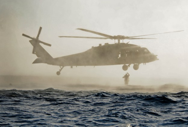 U.S. Navy SEALs jump out of an SH-60 Sea Hawk helicopter during a combat rescue swimmer course in MayUS Navy Photo