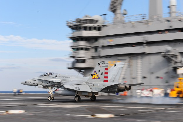 An F/A-18C Hornet, assigned to the Salty Dogs of Strike Aircraft Test Squadron (VX)23, tests the Joint Precision Approach Landing System (JPALS) aboard the aircraft carrier USS Theodore Roosevelt (CVN-71). US Navy Photo