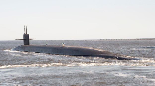 USS Tennessee (SSBN 734) pulls away from its escort boats in transit to its dive point in 2013. US Navy Photo