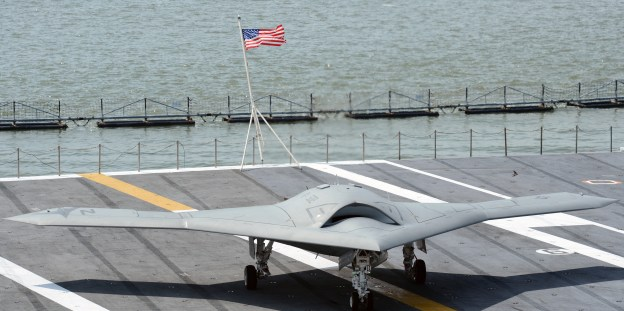 X-47B Unmanned Combat Air System (UCAS) demonstrator taxies on the flight deck of the aircraft carrier USS George H.W. Bush (CVN-77) in May 2013. US Navy Photo