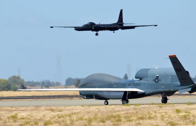 An RQ-4 Global Hawk taxies on the flightline as a U-2 makes its final approach Sept. 17, 2013, at Beale Air Force Base, Calif. US Air Force Photo