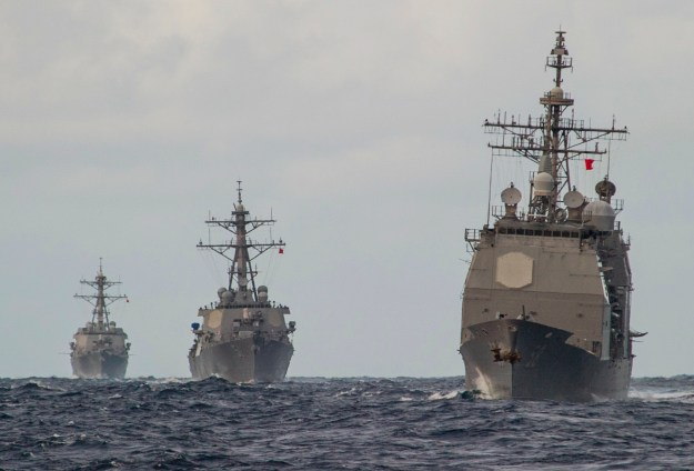USS Roosevelt (DDG-80) left,the guided missile destroyer USS Arleigh Burke (DDG-51) and the Ticonderoga-class guided-missile cruiser USS Philippine Sea (CG-58) on Feb. 19, 2014. US Navy Photo