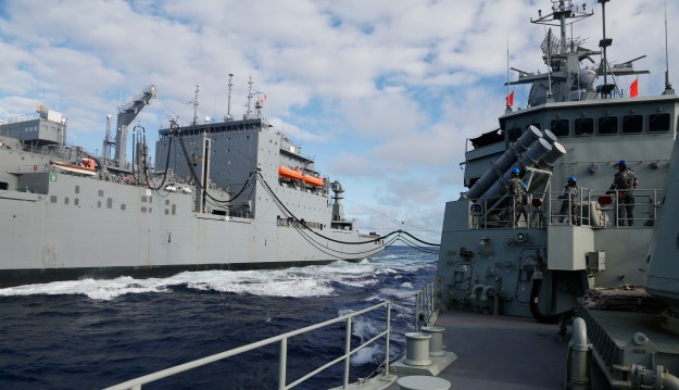 USNS Cesar Chavez (T-AKE 14) refuels the Royal Australian Navy frigate HMAS Perth (III) on April 12. US Navy Photo