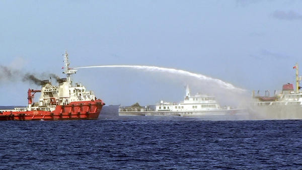 Chinese ships firing water cannons at Vietnamese patrol vessels. Vietnam National Border Committee Photo
