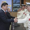 Chinese president Xi Jinping  and Russian president Vladimir Putin greet participants of Joint Sea-2014 exercise at Wusong naval port in Shanghai, east China, May 20, 2014. Xinhua Photo