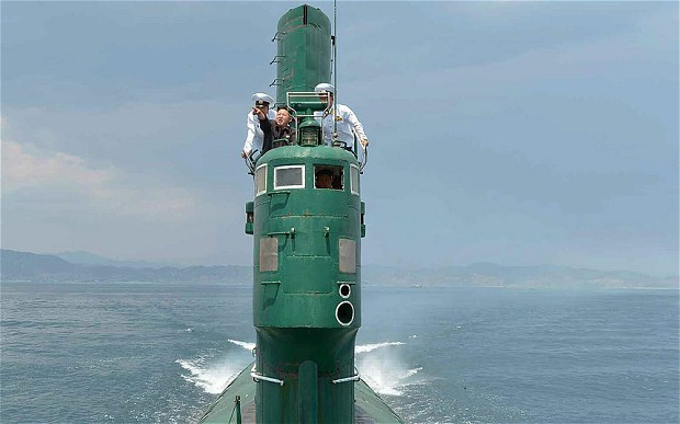 Kim Jong Un stands in the sail of what appears to be a Project 633 diesel submarine. KCNA Photo