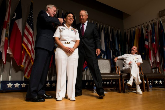 Secretary of the Navy (SECNAV) Ray Mabus, left, promotes Vice Adm. Michelle Howard to the rank of Admiral at the Women In Military Service For America Memorial in Arlington, Va. US Navy Photo