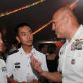People's Liberation Army Navy officers with a U.S. officer on a Chinese warship in Hawaii, June 28, 2014. PLA Daily Photo