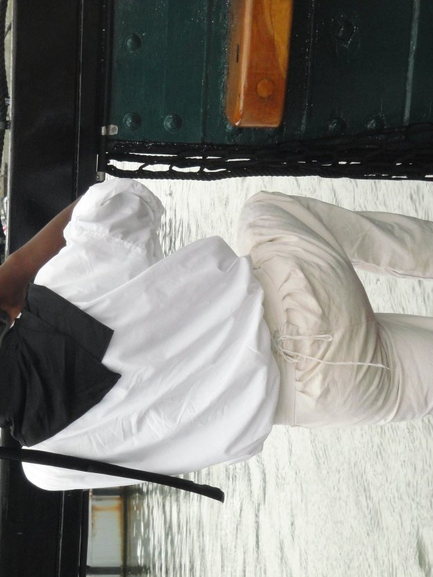 A sailor makes a quick phone call during a July 4, trip of USS Constitution in Boston Harbor. Glenn Moyer Photo