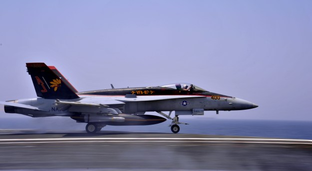 F/A-18C Hornet assigned to the Golden Warriors of Strike Fighter Squadron (VFA) 87 takes off from the flight deck of the aircraft carrier USS George H.W. Bush (CVN-77) in the Persian Gulf on Aug. 10, 2014. US Navy Photo
