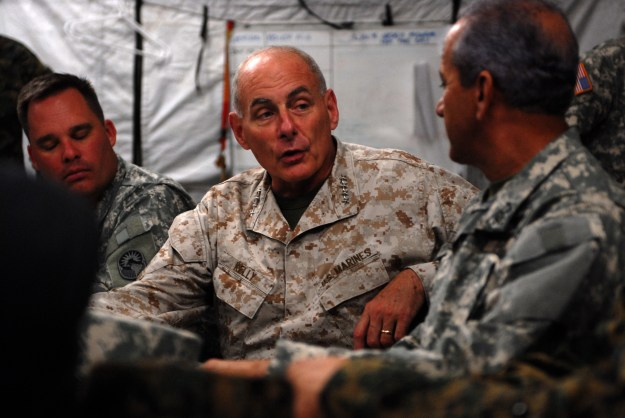 Marine Corps Gen. John F. Kelly, center, commander of U.S. Southern Command, speaks with Adm. Sigifrido Pared Perez, Dominican Republic minister of defense, in Barahona, Dominican Republic on June 9, 2014. SOUTHCOM Photo