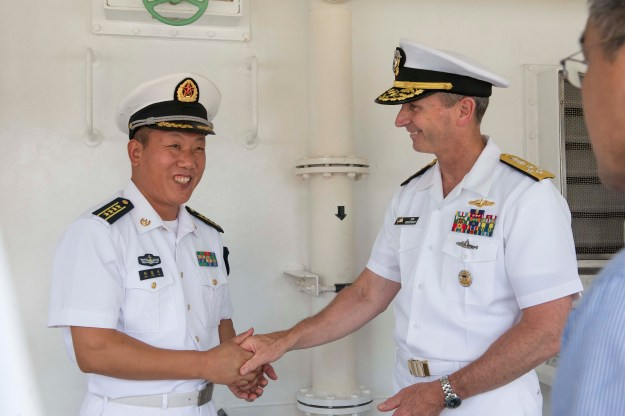 Adm. Jonathan Greenert thanks People's Liberation Army Navy (PLAN) Rear Adm. Sun Leng on July, 17 2014 in Dalian, China. US Navy Photo