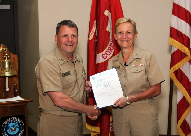 Vice Adm. Nora W. Tyson (right) and Adm. Bill Gortney, commander U.S. Fleet Forces (USFF) hold a letter authorizing her to put on a third star during a promotion ceremony in 2013. US Navy Photo