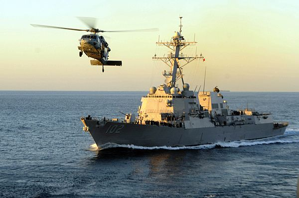 USS Sampson (DDG-102) and an MH-60S Sea Hawk in 2010. US Navy Photo